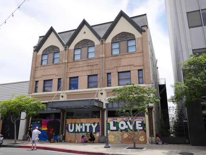 """Photo of the Masonic Temple with mural reading """"Unity"""" and """"Love."""""""